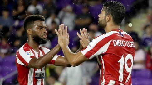 Lemar y Diego Costa durante un partido con el Atlético. (AFP)
