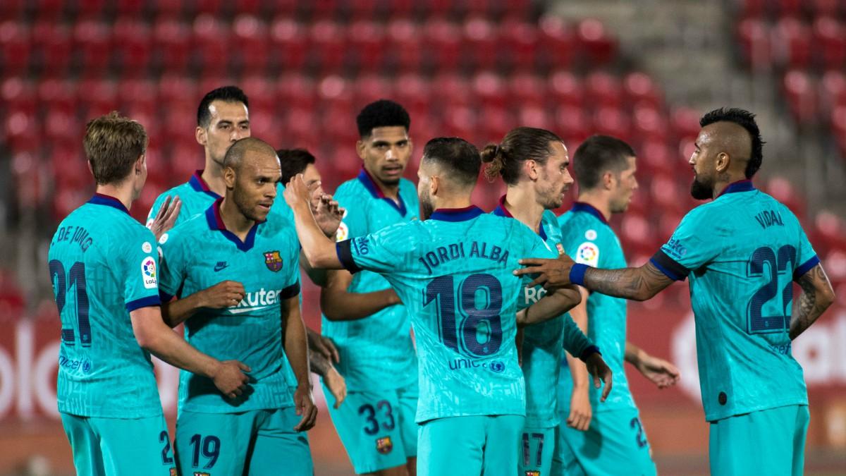 Los jugadores del Barcelona celebran un gol contra el Mallorca. (AFP)