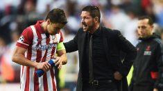 Gabi Fernández y el Cholo Simeone, durante un partido del Atlético de Madrid. (Getty)