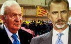 Juan Carlos I y Felipe VI con independentistas de fondo