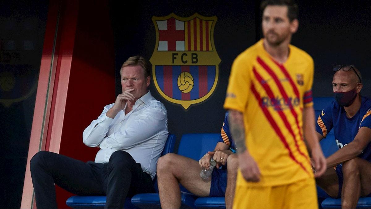 Koeman y Messi, en el partido contra el Nástic. (EFE)