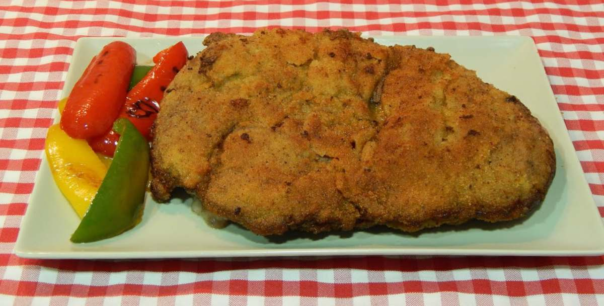 Receta original de cachopo de jamón y queso curado