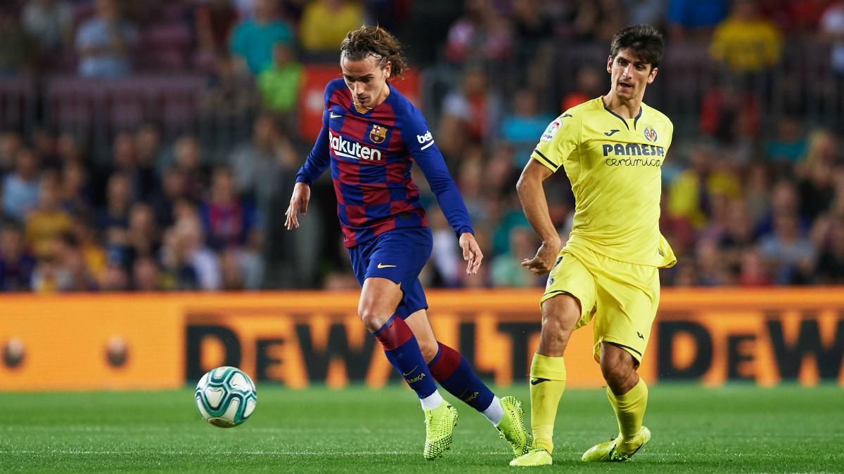Griezmann y Gerard Moreno disputan un balón durante un Barcelona-Villarreal. (Getty)