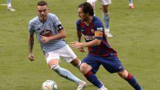 Iago Aspas y Leo Messi disputan un balón en el Celta-Barcelona. (Getty)