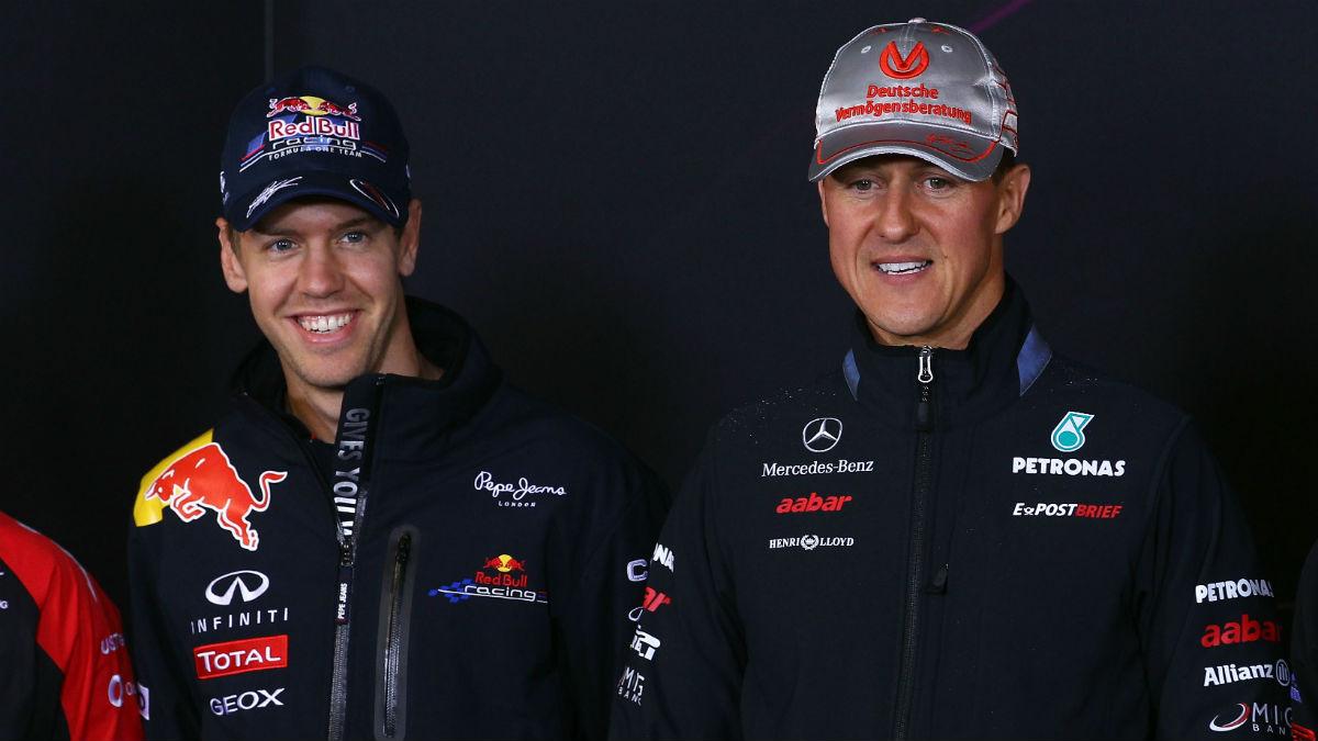 Sebastian Vettel, junto a Michael Schumacher en una foto de archivo. (Getty)