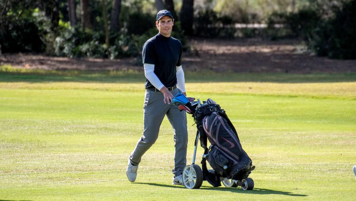 Rafael Nadal, en el campeonato de Baleares de golf. (EFE)
