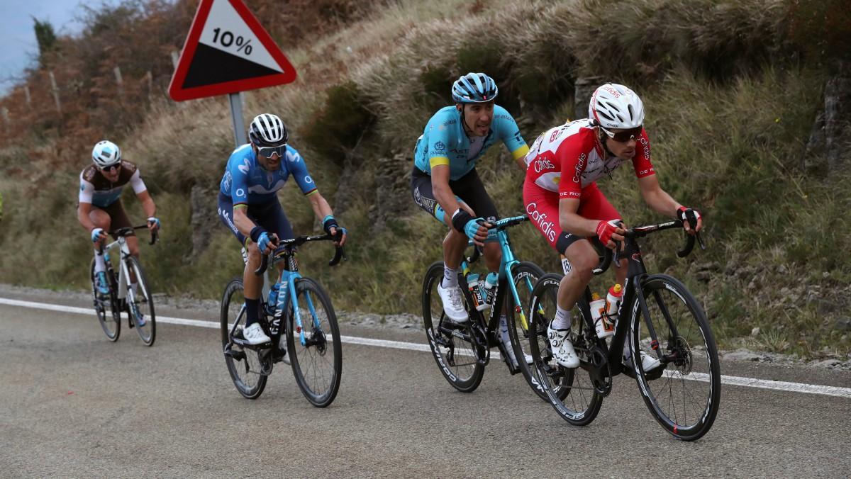 Martin, Fraile, Valverde y Peters, en persecución de Woods. (EFE)