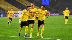 Sancho, Haaland y Hazard celebran un gol. (Getty)