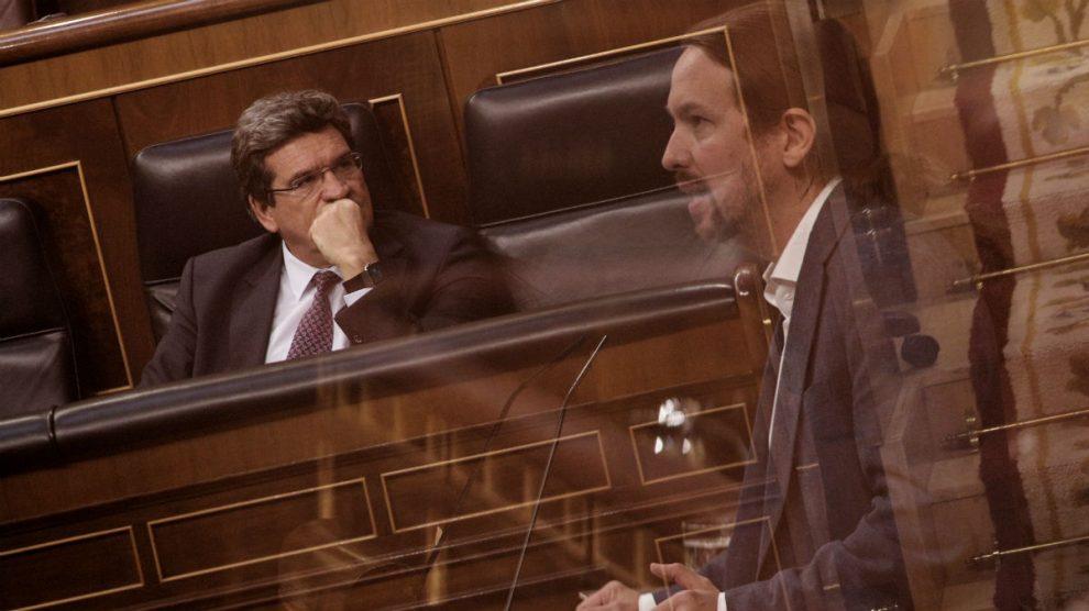 El ministro de Inclusión, Seguridad Social y Migraciones, José Luis Escrivá, y el vicepresidente social, Pablo Iglesias. (Foto: EP)