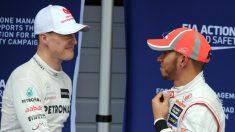 Michael Schumacher y Fernando Alonso. (AFP)