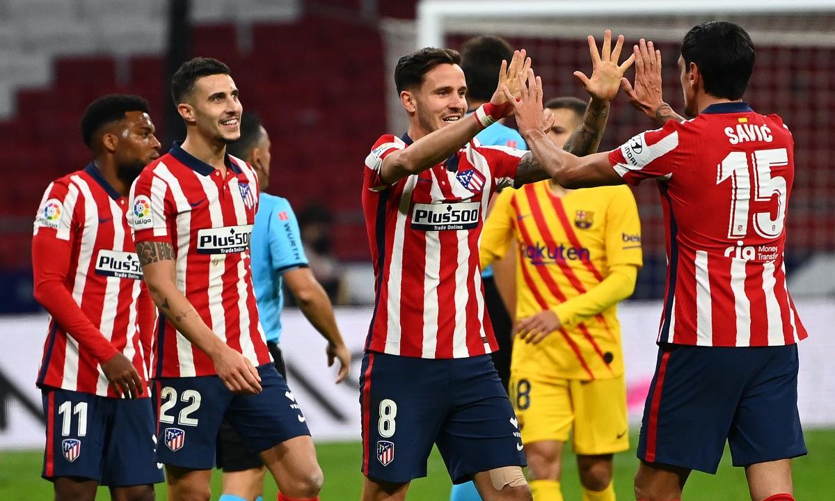 Los jugadores del Atlético de Madrid celebran su triunfo ante el Barcelona. (AFP)