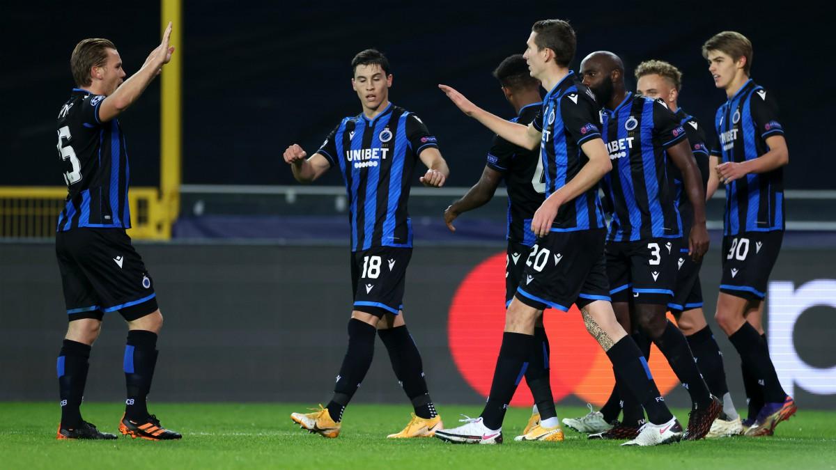 Los jugadores del Brujas celebran un gol. (AFP)