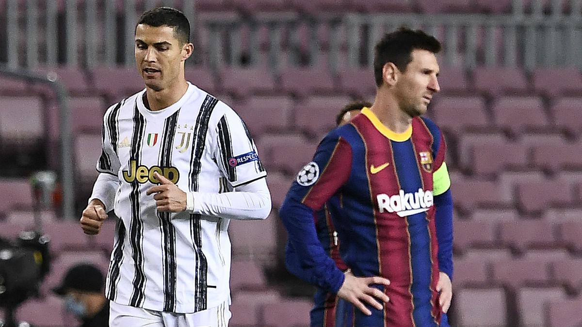 Cristiano Ronaldo y Messi, en el Barcelona-Juventus. (AFP)