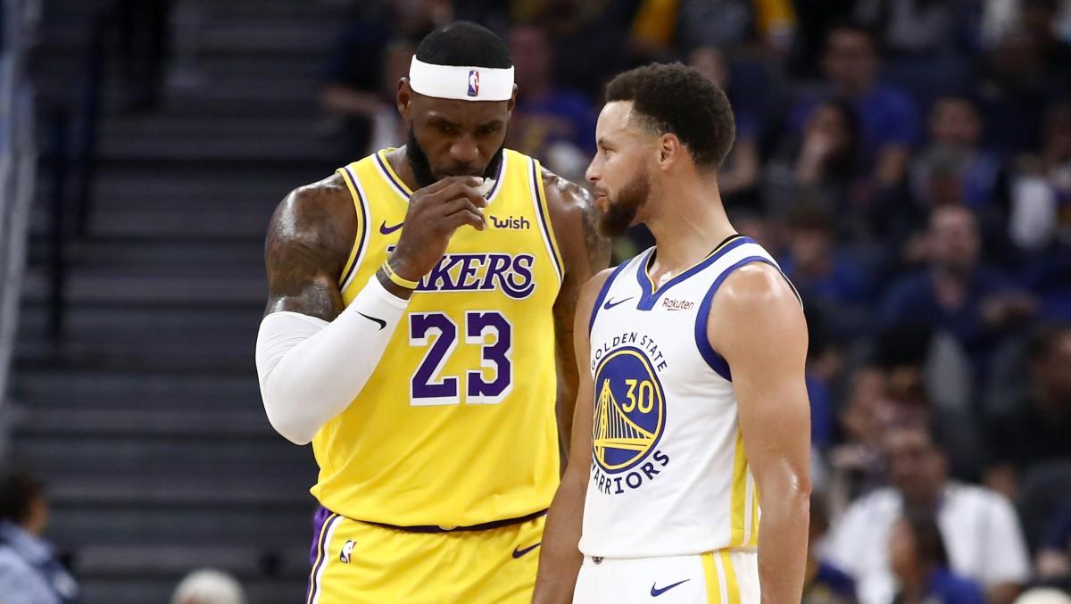 LeBron James y Stephen Curry, en un partido. (Getty)