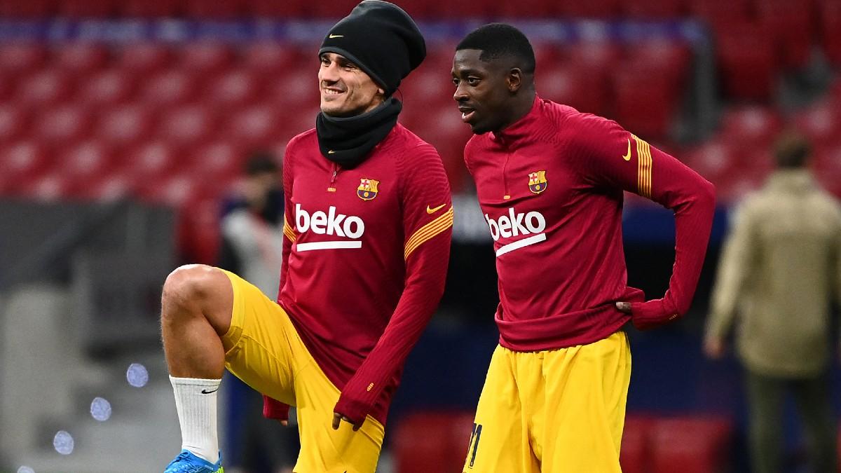 Griezmann y Dembélé calientan juntos antes de un partido. (AFP)