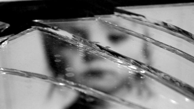 arreglar un espejo roto