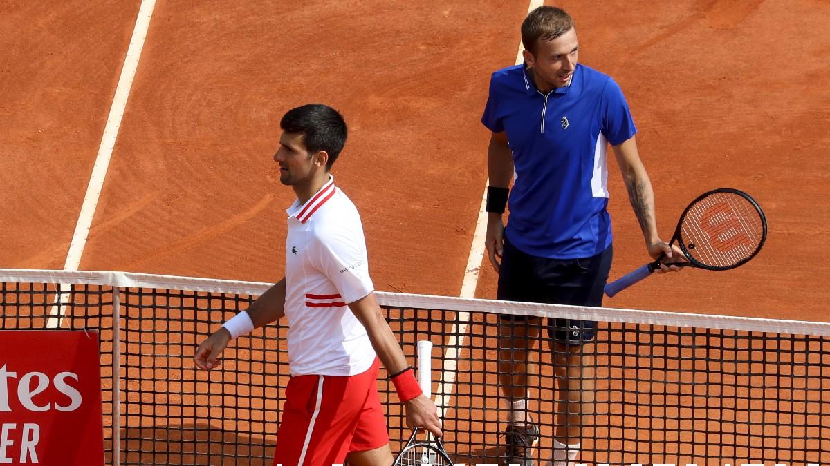 Djokovic se marcha tras su derrota ante Evans. (AFP)