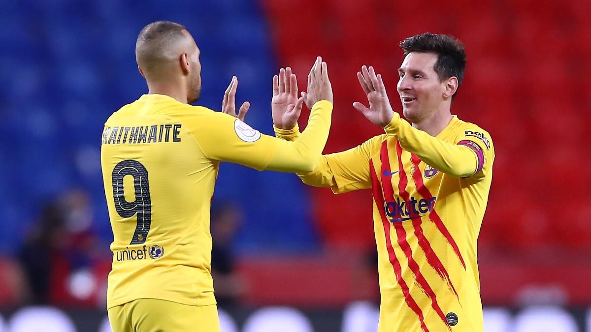 Braithwaite celebra un gol con Messi. (Getty)