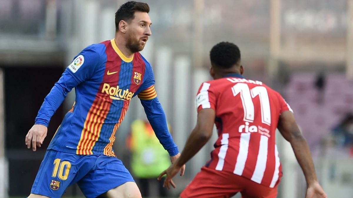 Messi y Lemar, en el partido del Camp Nou. (AFP)