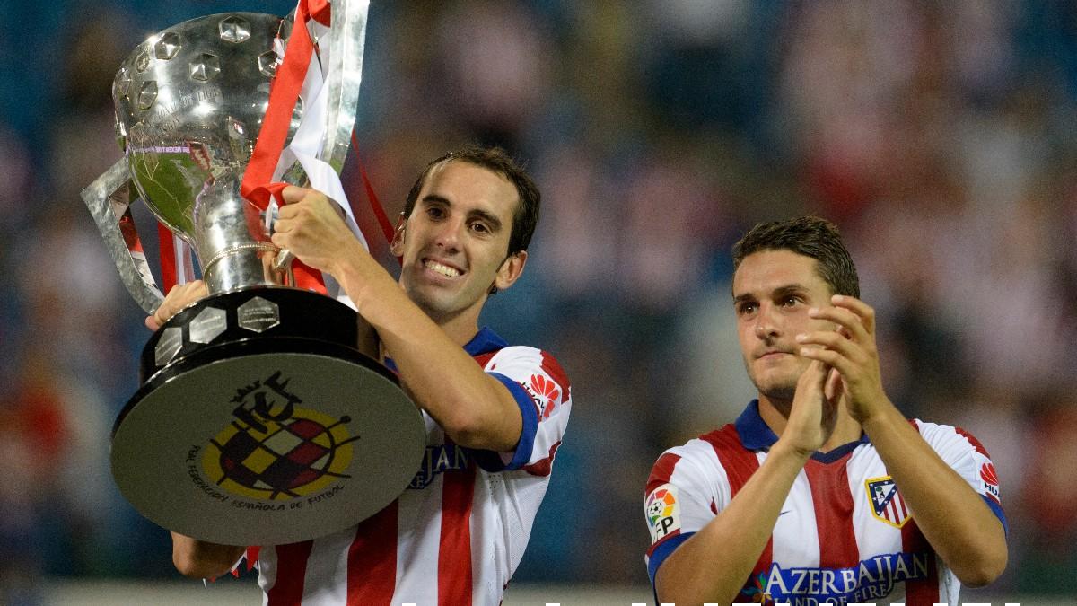 Godín y Koke, con la Liga que ganaron en 2014. (AFP)