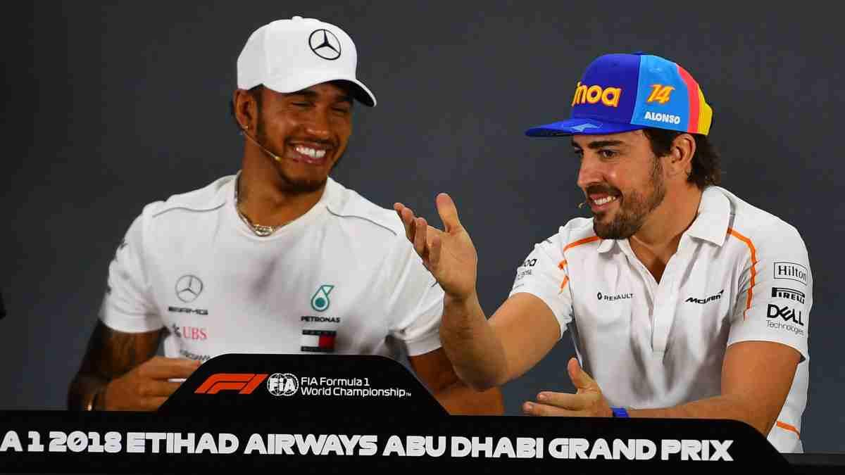 Lewis Hamilton y Fernando Alonso. (AFP)