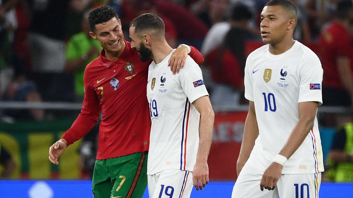 Cristiano y Benzema, con Mbappé en primer plano. (AFP)