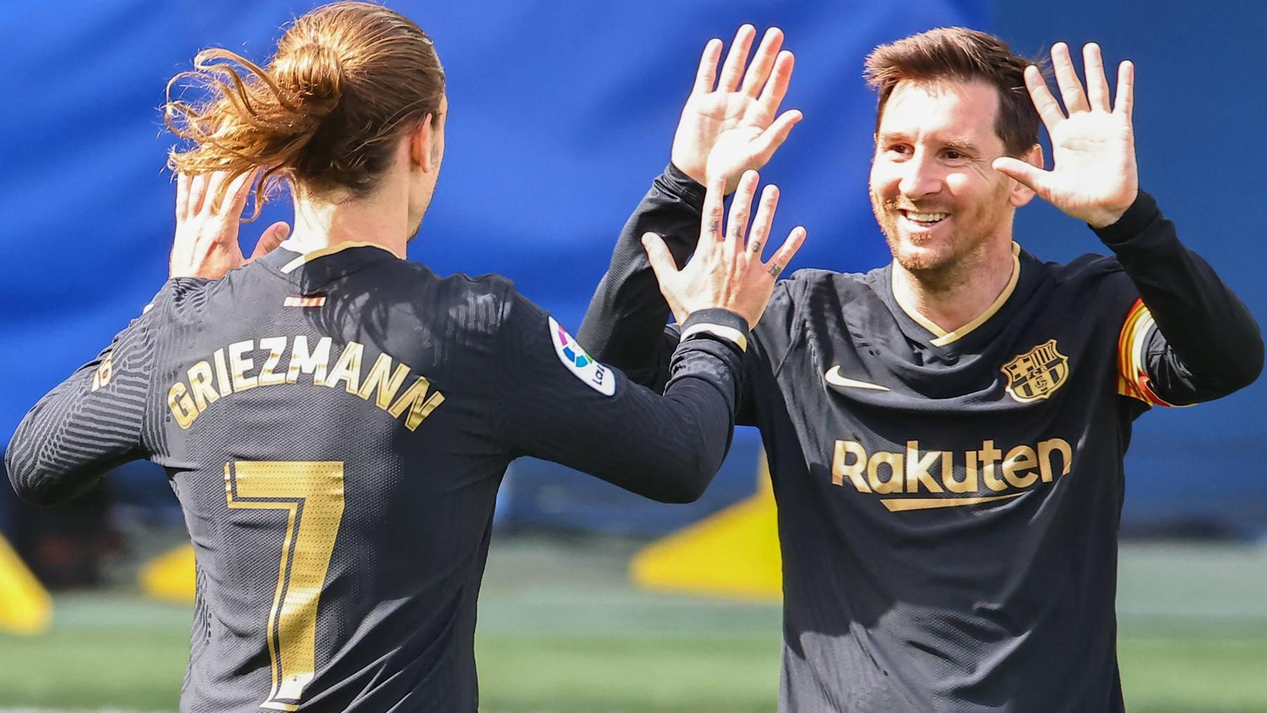 Griezmann y Messi celebran un gol con el Barcelona. (AFP)