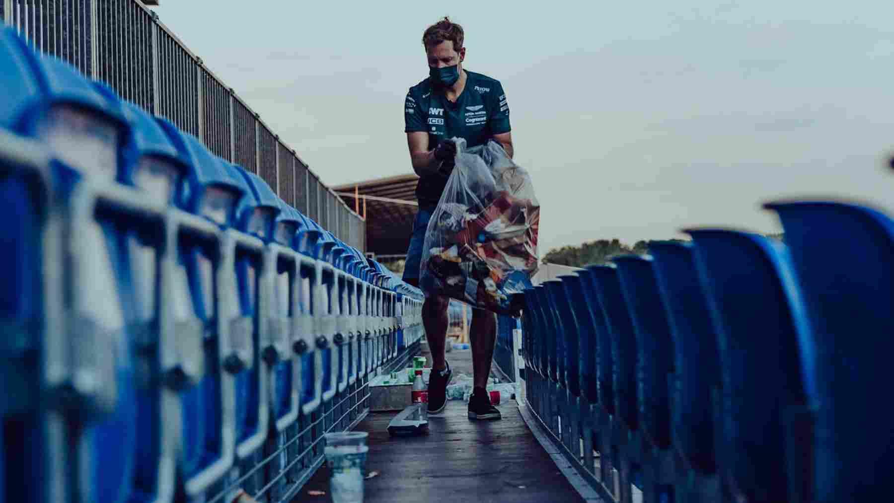 Sebastian Vettel ayudando a limpiar Silverstone (@AstonMartinF1)