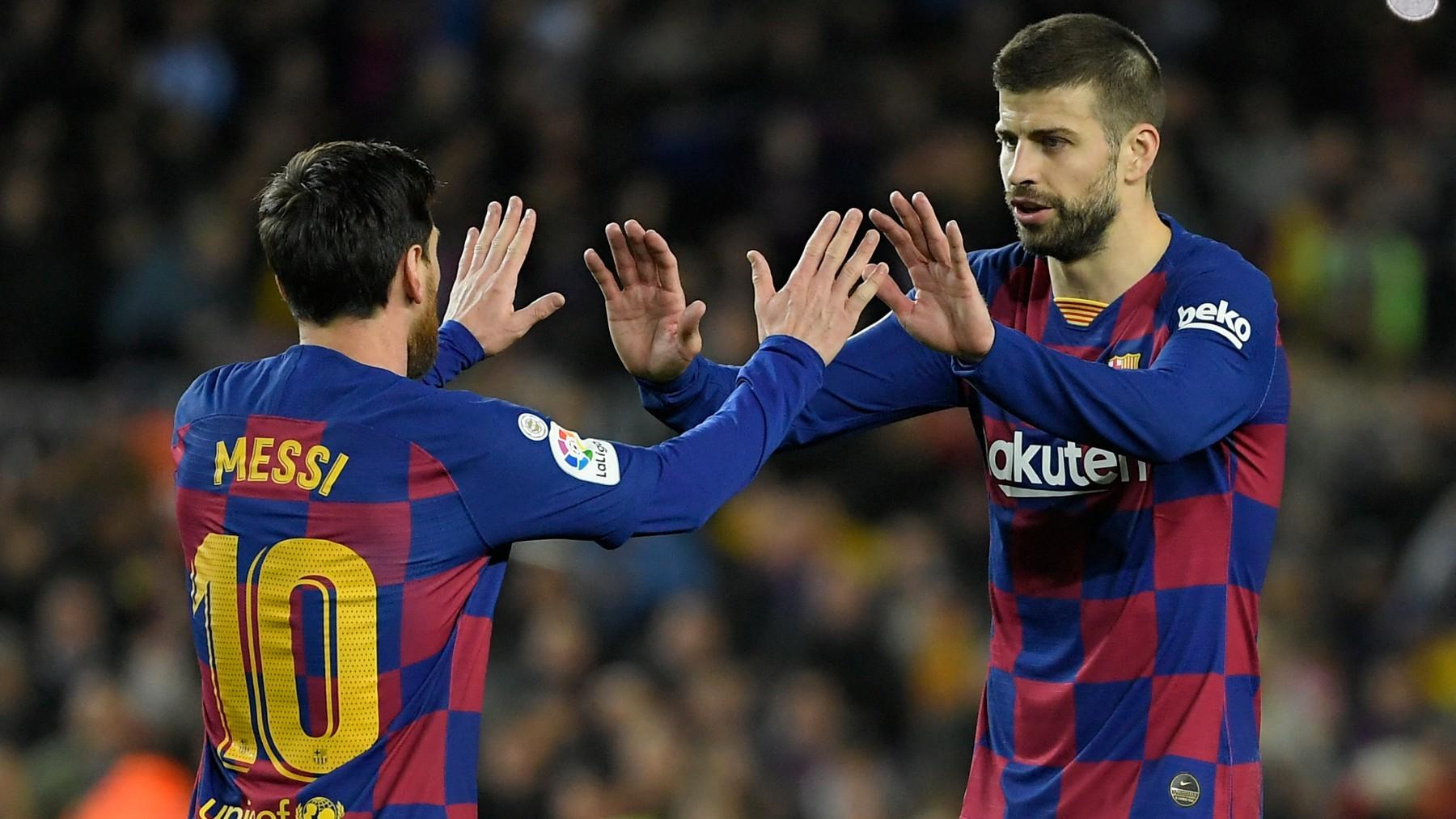 Piqué y Messi celebran un gol. (AFP)