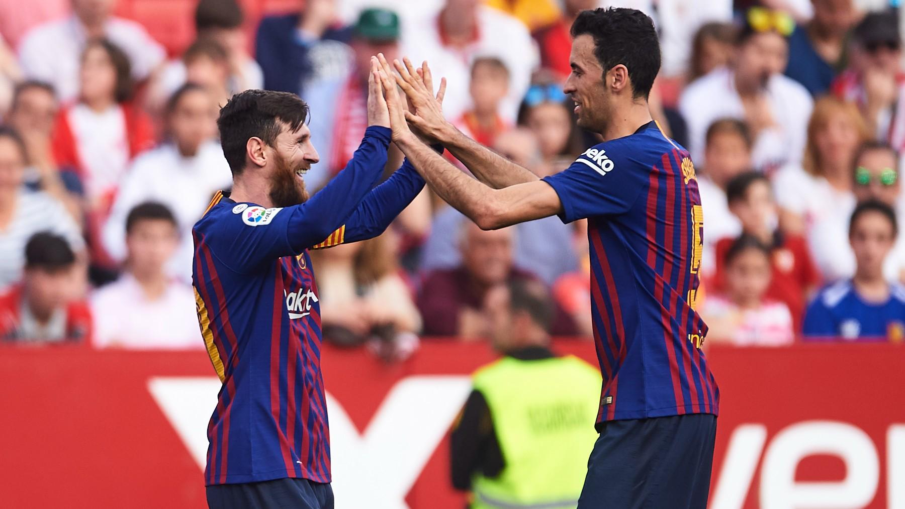Messi y Busquets, durante un partido con el Barcelona. (Getty)