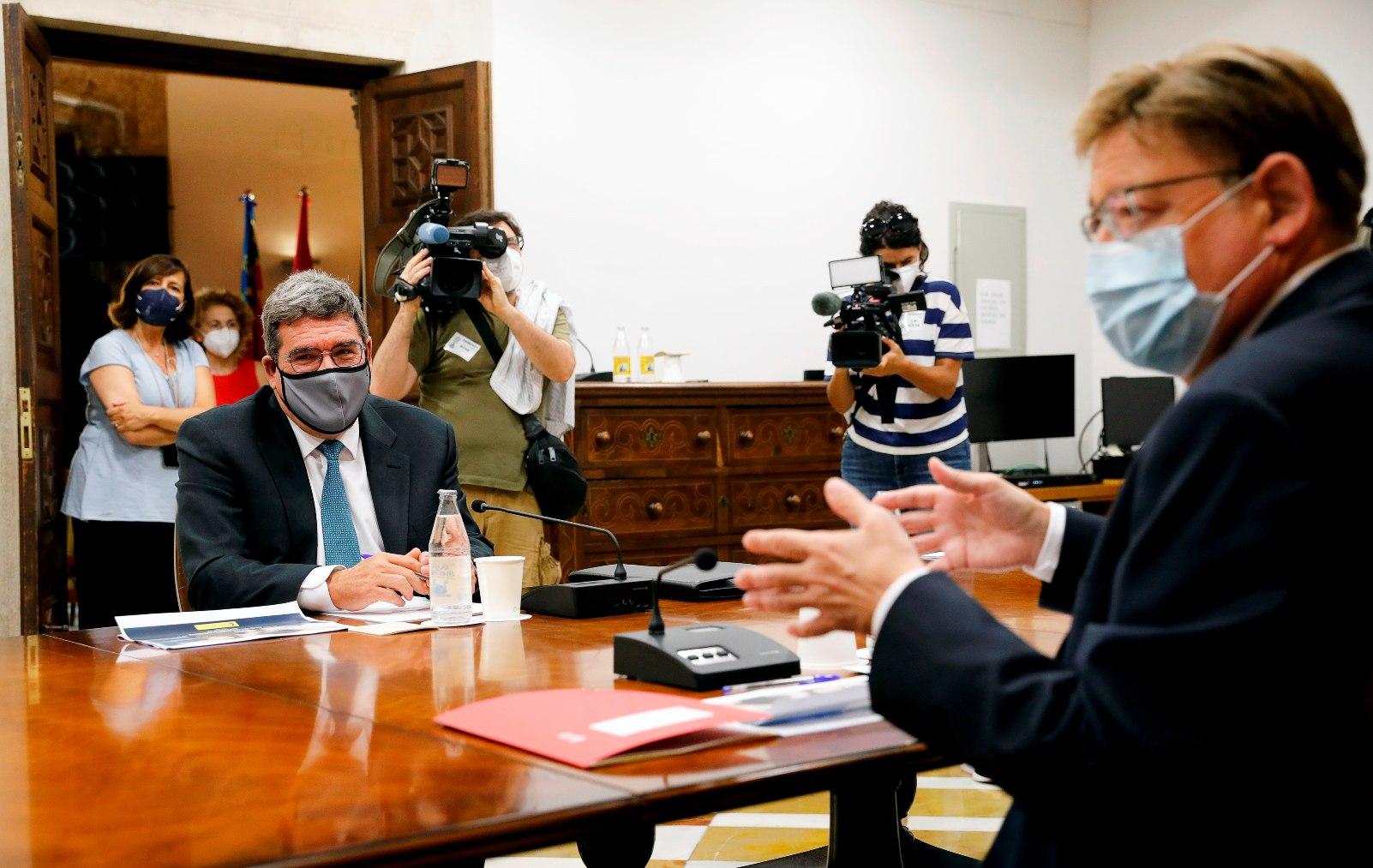 El ministro de Inclusión, José Luis Escrivá, con el presidente valenciano, Ximo Puig.