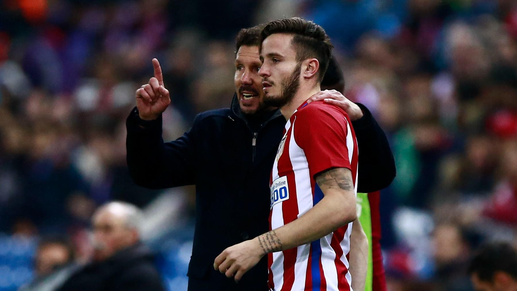 Simeone y Saúl, durante un partido. (Getty)