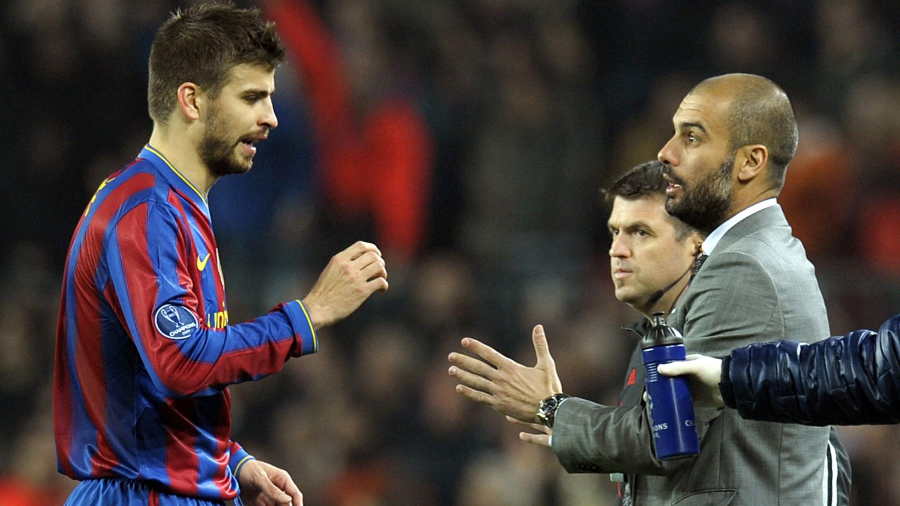 Piqué y Guardiola durante un partido con el Barcelona. (AFP)