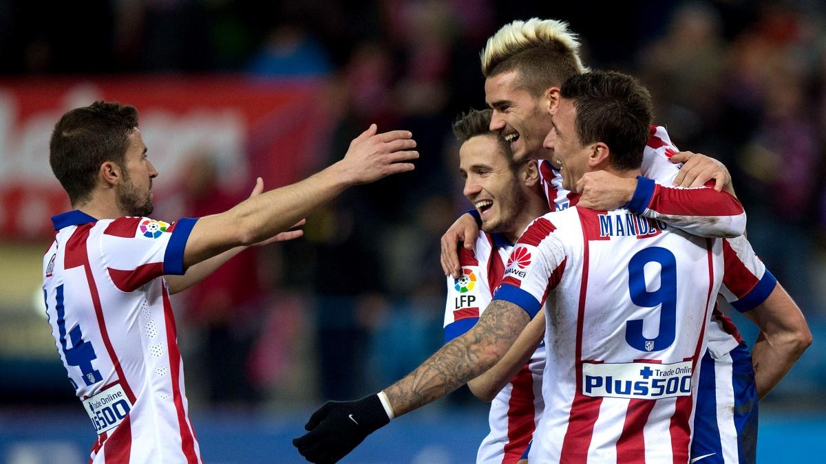 Gabi, Saúl, Griezmann y Mandzukic celebran un gol del Atlético
