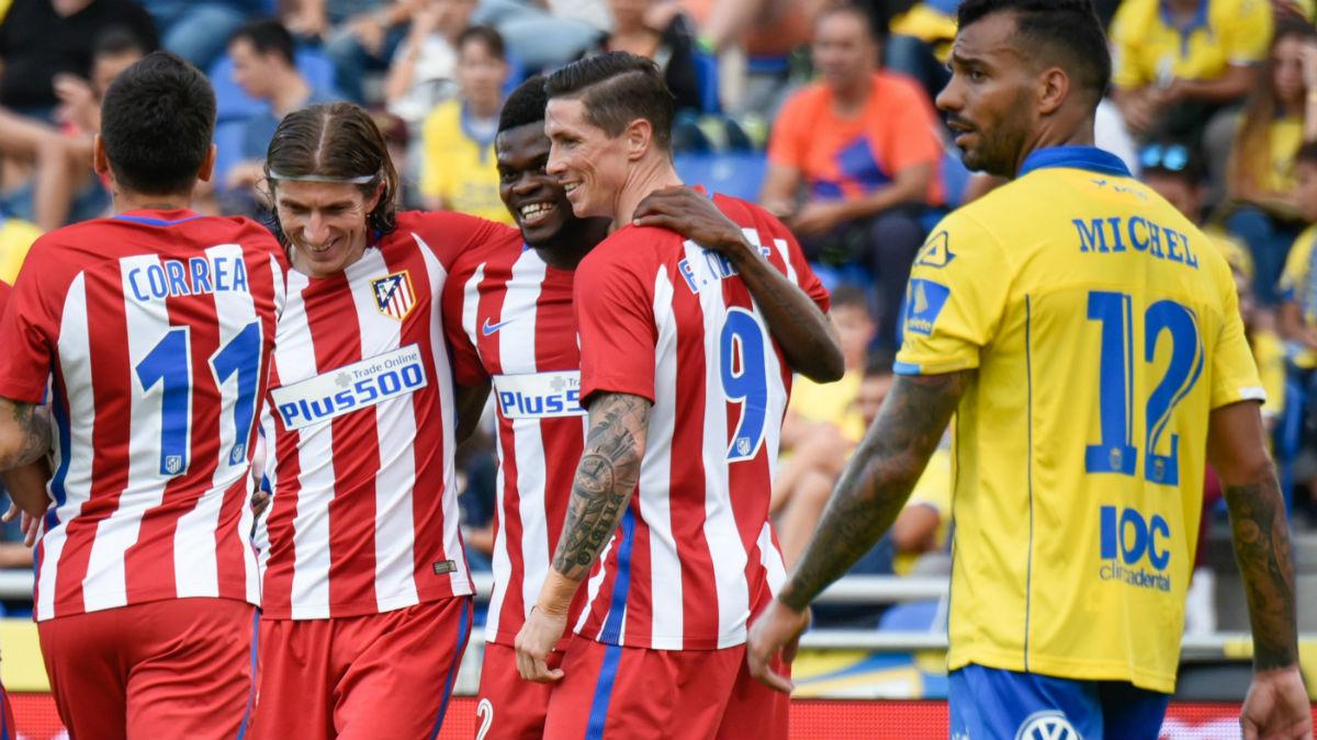 Los jugadores del Atlético celebran un gol contra Las Palmas. (AFP)