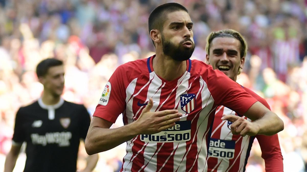 Yannick Carrasco celebra su gol durante el Atlético vs Sevilla