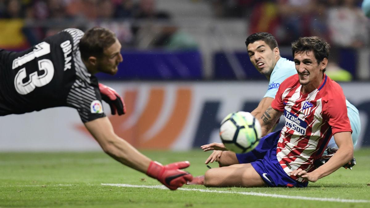 Luis Suárez consiguió empatar el partido en el Metropolitano. (AFP)