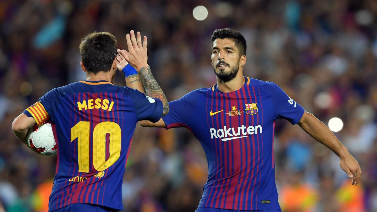 Luis Suárez y Messi celebran un gol. (AFP)