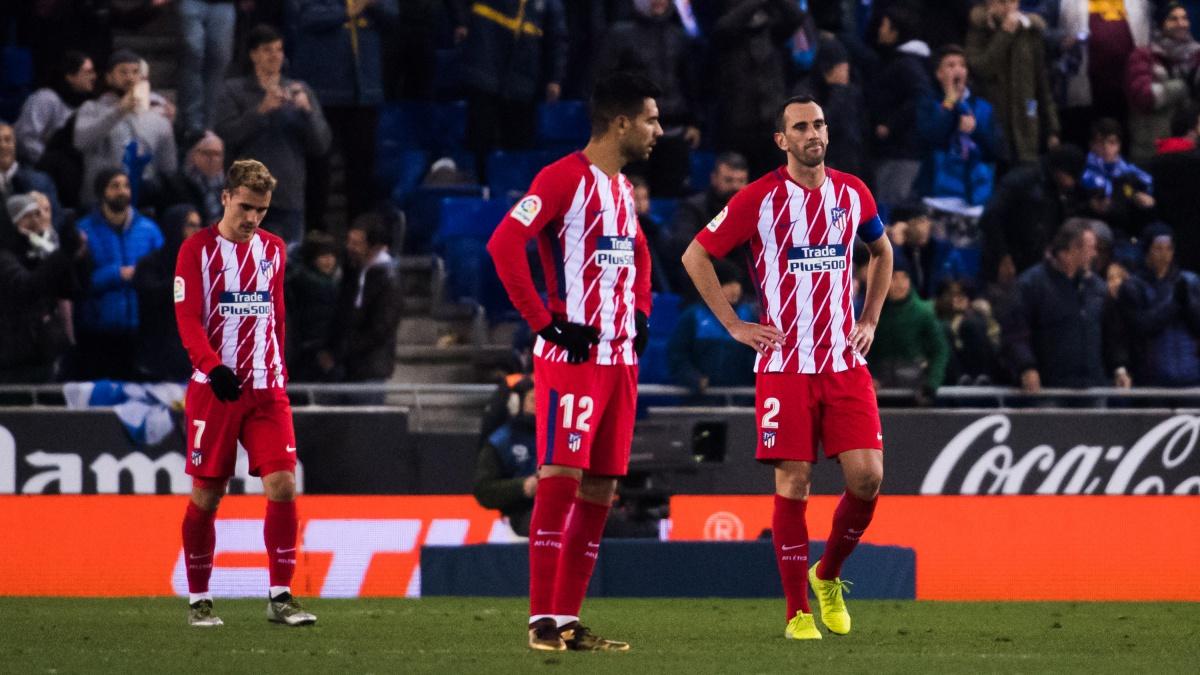 Griezmann, Godín y Augusto se lamentan tras el gol del Espanyol (Getty)
