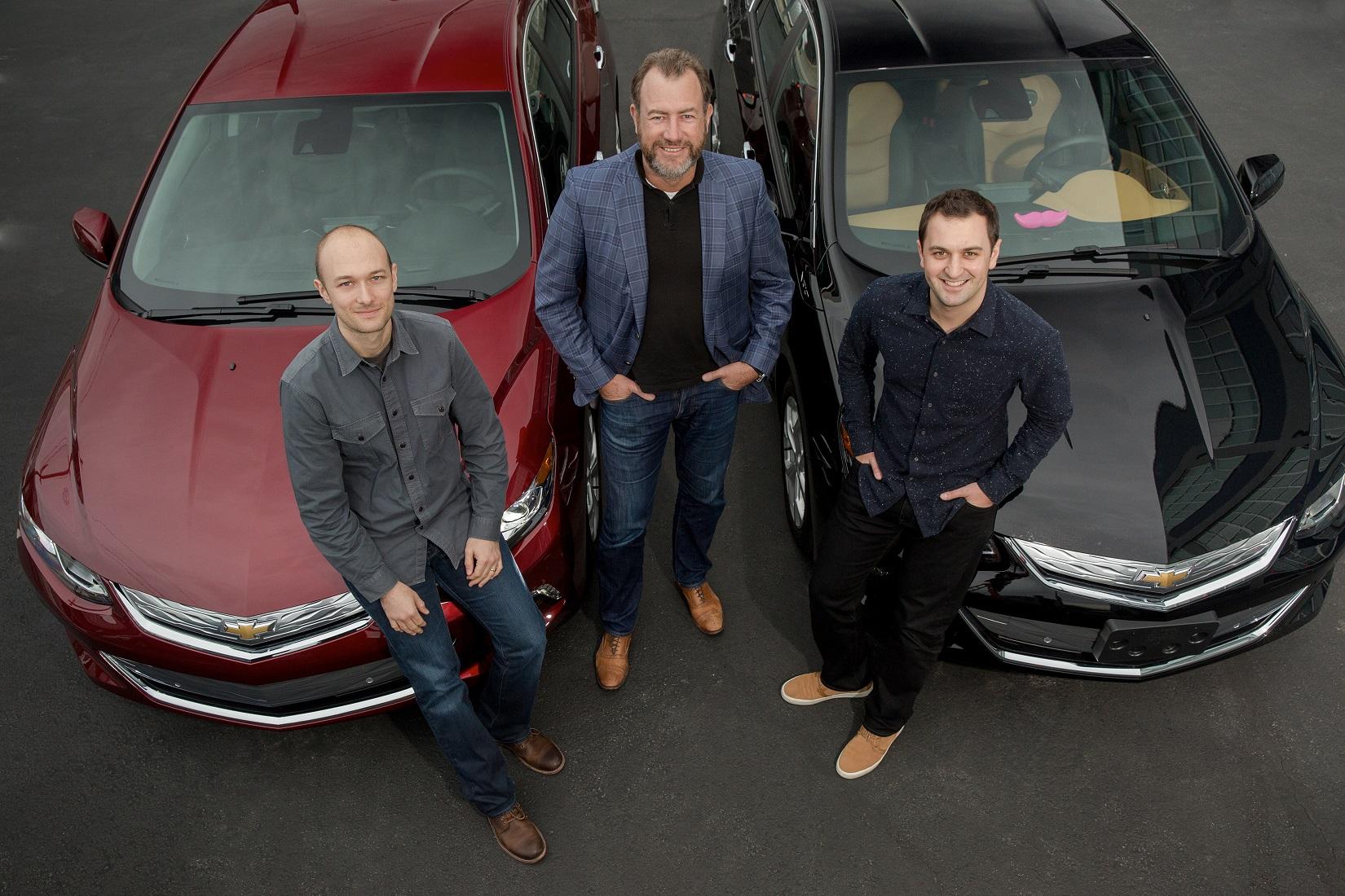 General Motors President Dan Ammann (center) with Lyft Inc. co-f
