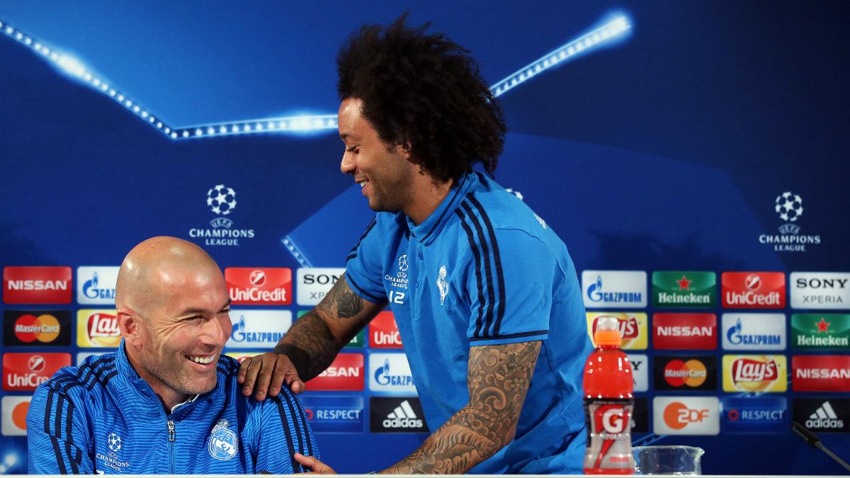 Marcelo y Zidane durante una rueda de prensa en Champions. (AFP)