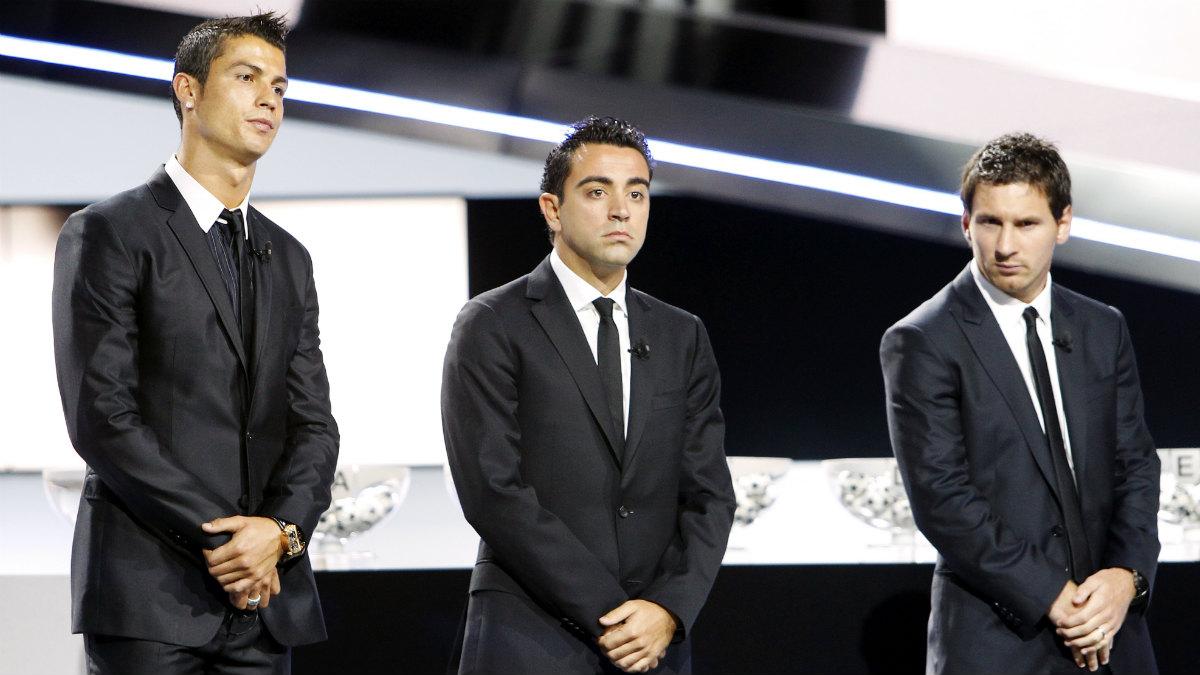 Cristiano, Xavi y Messi, en el podio del Balón de Oro. (AFP)