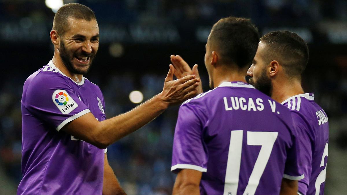 Benzema, Lucas y Carvajal, celebrando el gol del francés.