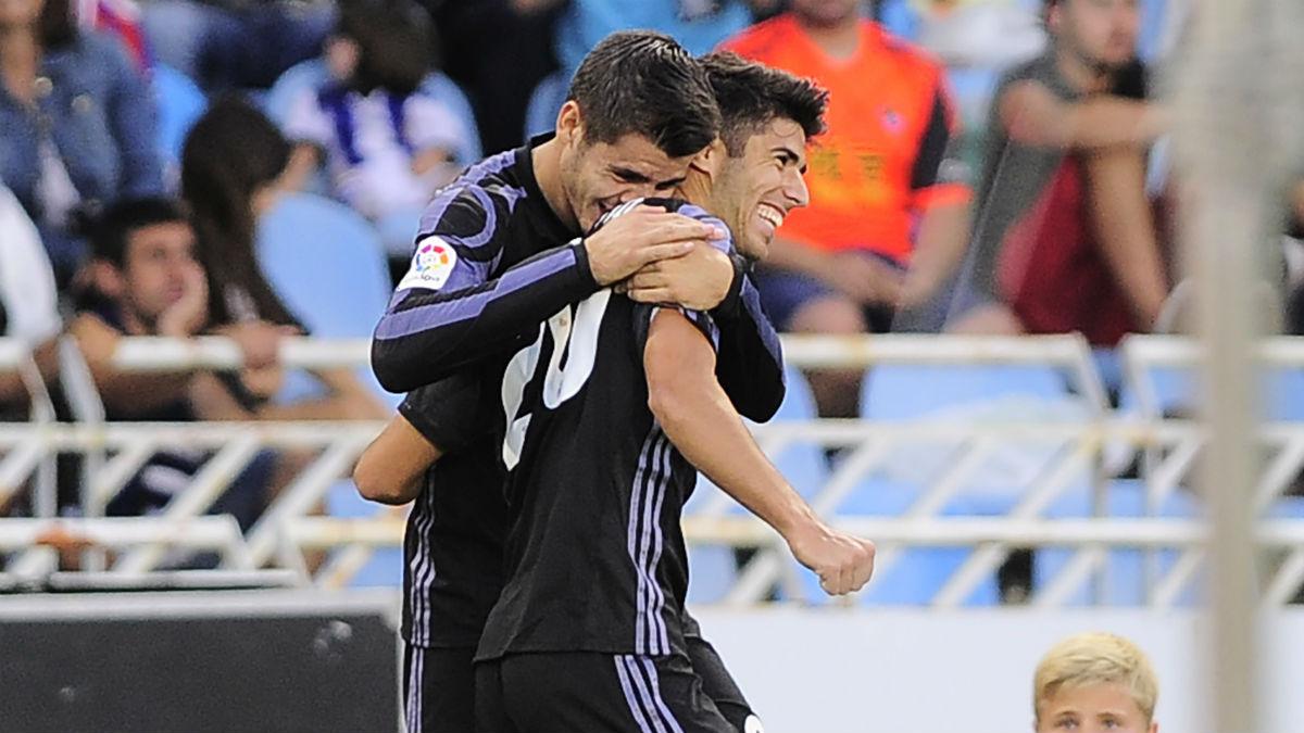 Asensio y Morata celebran un gol. (AFP)