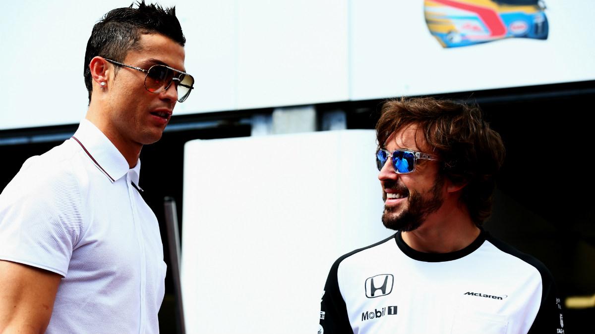 Fernando Alonso, junto a Cristsiano Ronaldo. (Getty)