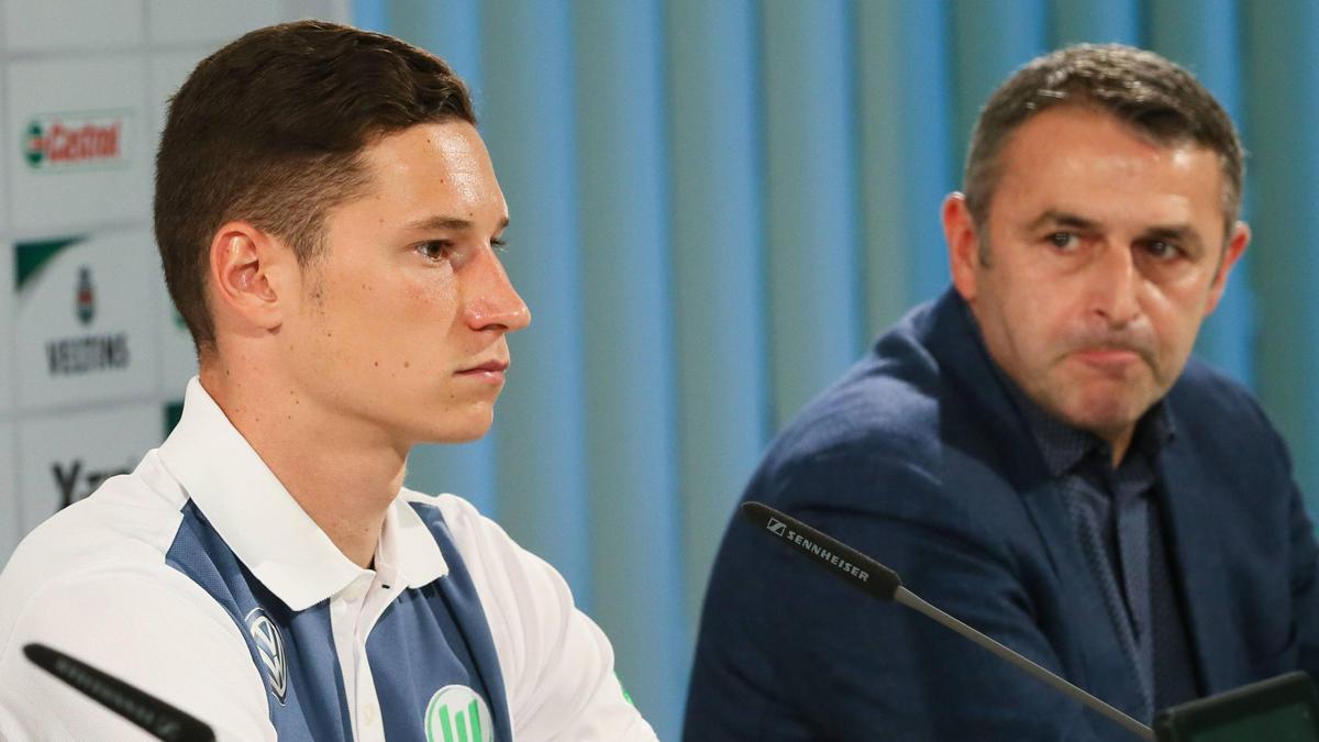 Klaus Allofs y Draxler, en rueda de prensa.