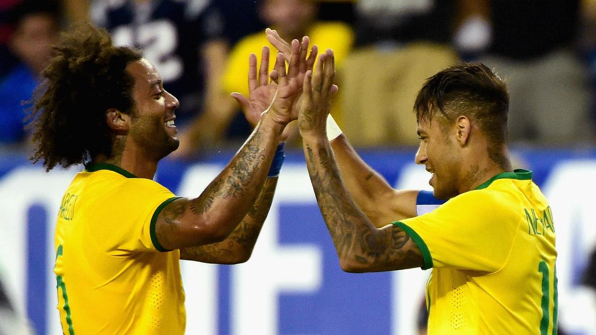 Neymar y Marcelo durante un partido con Brasil. (Getty)