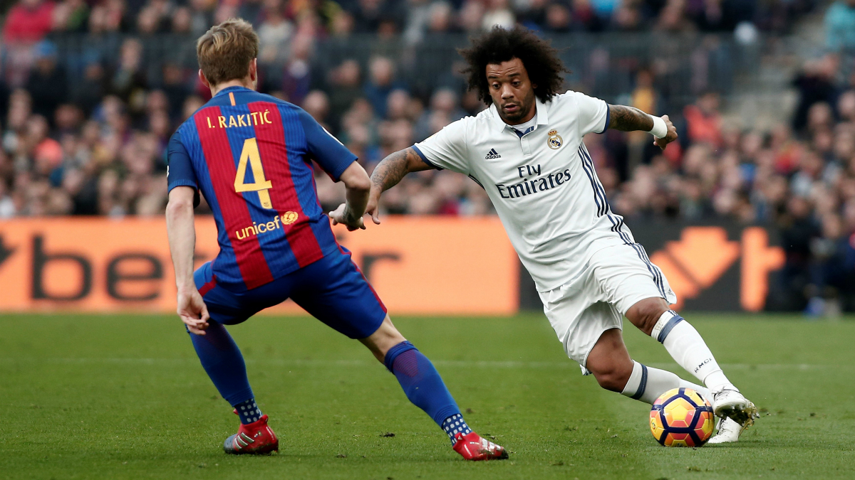 Marcelo y Rakitic, en el último Barcelona vs Real Madrid. (Getty)