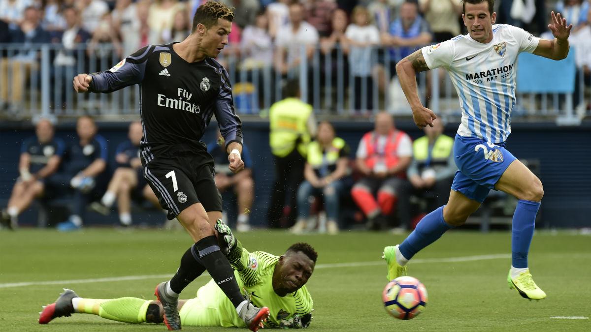 Cristiano dribla a Kameni y marca el 0-1. (AFP)