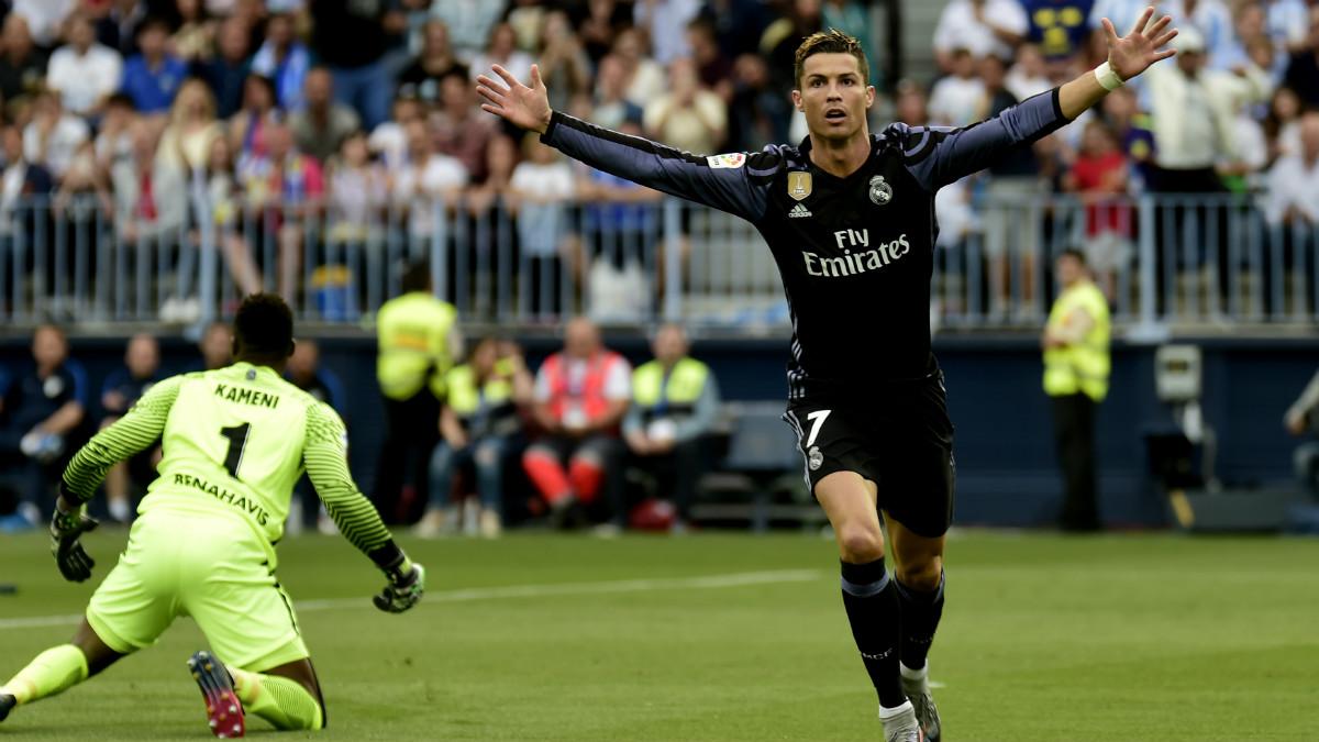 Cristiano celebra su gol ante el Málaga. (AFP)